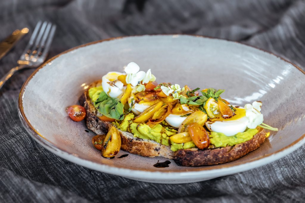 Avo on sourdough toast with eggs and tomatoes for breakfast could help boost your metabolism